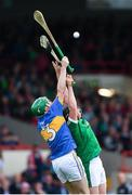 22 June 2017; Emmett Moloney of Tipperary in action against Peter Casey of Limerick during the Bord Gais Energy Munster GAA Under 21 Hurling Quarter-Final match between Limerick and Tipperary at the Gaelic Grounds in Limerick. Photo by Ramsey Cardy/Sportsfile