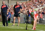 18 June 2017; Cork manager Kieran Kingston, left, and Cork selector Diarmuid O'Sullivan watch as Mark Coleman of Cork prepares to take a sideline cut during the Munster GAA Hurling Senior Championship Semi-Final match between Waterford and Cork at Semple Stadium in Thurles, Co Tipperary.  Photo by Piaras Ó Mídheach/Sportsfile