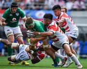 24 June 2017; Josh van der Flier of Ireland is tackled by Michael Leitch, left, and Takuma Asahara of Japan during the international rugby match between Japan and Ireland in the Ajinomoto Stadium in Tokyo, Japan. Photo by Brendan Moran/Sportsfile