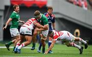 24 June 2017; Josh van der Flier of Ireland is tackled by Shintaro Ishihara, left, and Luke Thompson of Japan during the international rugby match between Japan and Ireland in the Ajinomoto Stadium in Tokyo, Japan. Photo by Brendan Moran/Sportsfile
