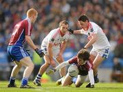 12 February 2012; David Wallis, Naomh Pádraig, Clonbur, supported by team-mate Declan Kyne, left, in action against Cathal O'Neill and Pat Campbell, right, Derrytresk Fir an Chnoic. AIB GAA Football All-Ireland Junior Club Championship Final, Naomh Pádraig, Clonbur, Galway v Derrytresk Fir an Chnoic, Tyrone, Croke Park, Dublin. Picture credit: Pat Murphy / SPORTSFILE
