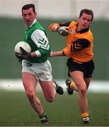 Leinster's John Donaldson holds off the challenge of Ulster's Pascal Canavan. Railway Cup semi-final. 26/1/97. Photograph: Ray McManus SPORTSFILE.