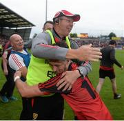 24 June 2017; Down manager Eamonn Burns and Ryan Johnston of Down celebrate after the Ulster GAA Football Senior Championship Semi-Final match between Down and Monaghan at the Athletic Grounds in Armagh. Photo by Daire Brennan/Sportsfile