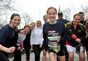 17 February 2012; European Cross Country Champion Fionnuala Britton with participants, including Henry McKean of Newstalk, right, who turned up for the SPAR Great Ireland Run flash lap lunchtime run around Merrion Square. The SPAR Great Ireland Run is on Sunday 15th April in the Phoenix Park, Dublin. Entries and info at www.greatirelandrun.org. Merrion Square, Dublin. Picture credit: Brian Lawless / SPORTSFILE