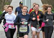 17 February 2012; European Cross Country Champion Fionnuala Britton with participants, including Henry McKean of Newstalk, who turned up for the SPAR Great Ireland Run flash lap lunchtime run around Merrion Square. The SPAR Great Ireland Run is on Sunday 15th April in the Phoenix Park, Dublin. Entries and info at www.greatirelandrun.org. Merrion Square, Dublin. Picture credit: Brian Lawless / SPORTSFILE