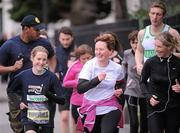 17 February 2012; European Cross Country Champion Fionnuala Britton with participants who took part in the SPAR Great Ireland Run flash lap lunchtime run around Merrion Square. The SPAR Great Ireland Run is on Sunday 15th April in the Phoenix Park, Dublin. Entries and info at www.greatirelandrun.org. Merrion Square, Dublin. Picture credit: Brian Lawless / SPORTSFILE