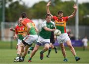 25 June 2017; Mark Gottsche of London in action against Danny Moran, left, Conor Lawlor, centre, and Brendan Murphy of Carlow during the GAA Football All-Ireland Senior Championship Round 1B match between London and Carlow at McGovern Park in Ruislip, London. Photo by Seb Daly/Sportsfile