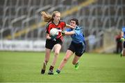 25 June 2017; Clodagh Kennedy of Killygarry, Co. Cavan in action against Saoirse Kellt of Westport, Co. Mayo during the Girls Division 1 Shield Final at the John West Peile na nÓg national competition which took place this weekend across Cavan, Fermanagh and Monaghan. This is the second year that the Féile na nGael and Féile Peile na nÓg have been sponsored by John West, one of the world's leading suppliers of fish. The competition gives up-and-coming GAA superstars the chance to participate and play in their respective Féile tournament, at a level which suits their age, skills and strengths.   Photo by Matt Browne/Sportsfile