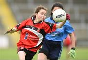 25 June 2017; Faith Galligan of Killygarry, Co. Cavan in action against Saoires Kelly of Westport, Co. Mayo during the Girls Division 1 Shield Final at the John West Peile na nÓg national competition which took place this weekend across Cavan, Fermanagh and Monaghan. This is the second year that the Féile na nGael and Féile Peile na nÓg have been sponsored by John West, one of the world's leading suppliers of fish. The competition gives up-and-coming GAA superstars the chance to participate and play in their respective Féile tournament, at a level which suits their age, skills and strengths.   Photo by Matt Browne/Sportsfile