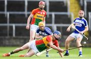 25 June 2017; Diarmuid Byrne of Carlow in action against Cahir Healy of Laois during the GAA Hurling All-Ireland Senior Championship Preliminary Round match between Laois and Carlow at O'Moore Park in Portlaoise, Co. Laois. Photo by Ramsey Cardy/Sportsfile