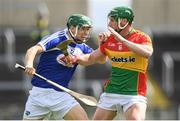 25 June 2017; Sean Downey of Laois is tackled by David English of Carlow during the GAA Hurling All-Ireland Senior Championship Preliminary Round match between Laois and Carlow at O'Moore Park in Portlaoise, Co. Laois. Photo by Ramsey Cardy/Sportsfile