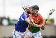 25 June 2017; Richard Kelly of Carlow is tackled by Neil Foyle of Laois during the GAA Hurling All-Ireland Senior Championship Preliminary Round match between Laois and Carlow at O'Moore Park in Portlaoise, Co. Laois. Photo by Ramsey Cardy/Sportsfile