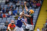 25 June 2017; Brian Tracey of Carlow in action against Neil Foyle of Laois during the GAA Hurling All-Ireland Senior Championship Preliminary Round match between Laois and Carlow at O'Moore Park in Portlaoise, Co. Laois. Photo by Ramsey Cardy/Sportsfile