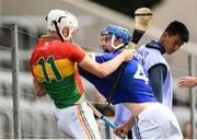 25 June 2017; Martin Kavanagh of Carlow tussles with Lee Cleere of Laois during the GAA Hurling All-Ireland Senior Championship Preliminary Round match between Laois and Carlow at O'Moore Park in Portlaoise, Co. Laois. Photo by Ramsey Cardy/Sportsfile