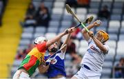 25 June 2017; Chris Nolan of Carlow in action against Donncha Hartnett, centre, and Enda Rowland of Laois during the GAA Hurling All-Ireland Senior Championship Preliminary Round match between Laois and Carlow at O'Moore Park in Portlaoise, Co. Laois. Photo by Ramsey Cardy/Sportsfile