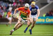 25 June 2017; James Doyle of Carlow in action against Leigh Bergin of Laois during the GAA Hurling All-Ireland Senior Championship Preliminary Round match between Laois and Carlow at O'Moore Park in Portlaoise, Co. Laois. Photo by Ramsey Cardy/Sportsfile