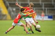 25 June 2017; Ryan Dempsey of St. Broughan's GAA Club, Co. Offaly in action against Mark Brady of Gowna GAA Club, Co. Cavan during the Boys Division 1 Shield Final at the John West Peile na nÓg national competition which took place this weekend across Cavan, Fermanagh and Monaghan. This is the second year that the Féile na nGael and Féile Peile na nÓg have been sponsored by John West, one of the world's leading suppliers of fish. The competition gives up-and-coming GAA superstars the chance to participate and play in their respective Féile tournament, at a level which suits their age, skills and strengths.   Photo by Matt Browne/Sportsfile
