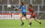 25 June 2017; Julia Piskporek of Westport, Co. Mayo in action against Faith Gilligan of Killygarry, Co. Cavan during the Girls Division 1 Shield Final at the John West Peile na nÓg national competition which took place this weekend across Cavan, Fermanagh and Monaghan. This is the second year that the Féile na nGael and Féile Peile na nÓg have been sponsored by John West, one of the world's leading suppliers of fish. The competition gives up-and-coming GAA superstars the chance to participate and play in their respective Féile tournament, at a level which suits their age, skills and strengths.   Photo by Matt Browne/Sportsfile