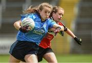 25 June 2017; Aoife Kennedy of Westport, Co. Mayo in action against Emma Comiskey of Killygarry, Co. Cavan during the Girls Division 1 Shield Final at the John West Peile na nÓg national competition which took place this weekend across Cavan, Fermanagh and Monaghan. This is the second year that the Féile na nGael and Féile Peile na nÓg have been sponsored by John West, one of the world's leading suppliers of fish. The competition gives up-and-coming GAA superstars the chance to participate and play in their respective Féile tournament, at a level which suits their age, skills and strengths.   Photo by Matt Browne/Sportsfile