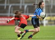 25 June 2017; Katie O'Grady of Westport, Co. Mayo in action against Faith Galligan of Killygarry, Co. Cavan during the Girls Division 1 Shield Final at the John West Peile na nÓg national competition which took place this weekend across Cavan, Fermanagh and Monaghan. This is the second year that the Féile na nGael and Féile Peile na nÓg have been sponsored by John West, one of the world's leading suppliers of fish. The competition gives up-and-coming GAA superstars the chance to participate and play in their respective Féile tournament, at a level which suits their age, skills and strengths.   Photo by Matt Browne/Sportsfile