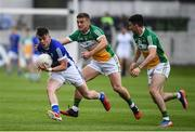 25 June 2017; Gerard Smith of Cavan is tackled by Ruairi McNamee, left, and Ruairi Allen of Offaly during the GAA Football All-Ireland Senior Championship Round 1B match between Offaly and Cavan at O'Connor Park in Tullamore, Co. Offaly. Photo by Ramsey Cardy/Sportsfile