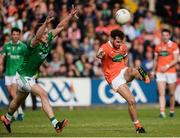 25 June 2017; Jamie Clarke of Armagh scoring a point despite the attention of Che Cullen of Fermanagh during the GAA Football All-Ireland Senior Championship Round 1B match between Armagh and  Fermanagh at the Athletic Grounds in Armagh. Photo by Oliver McVeigh/Sportsfile