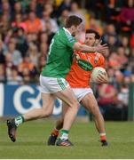 25 June 2017; Jamie Clarke of Armagh in action against Eoin Donnelly of Fermanagh  during the GAA Football All-Ireland Senior Championship Round 1B match between Armagh and  Fermanagh at the Athletic Grounds in Armagh. Photo by Oliver McVeigh/Sportsfile