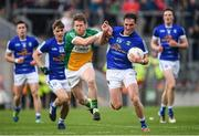 25 June 2017; Niall Clerkin of Cavan is tackled by Brian Darby of Offaly during the GAA Football All-Ireland Senior Championship Round 1B match between Offaly and Cavan at O'Connor Park in Tullamore, Co. Offaly. Photo by Ramsey Cardy/Sportsfile