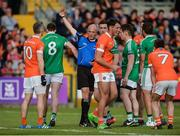 25 June 2017; Referee Cormac Reilly issues Eoin Donnelly of Fermanagh, 8, with a red card in the second half during the GAA Football All-Ireland Senior Championship Round 1B match between Armagh and  Fermanagh at the Athletic Grounds in Armagh. Photo by Oliver McVeigh/Sportsfile