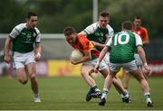 25 June 2017; Chris Crowley of Carlow in action against Rory Mason, left, Ryan Jones, centre, and Eoin Murray of London during the GAA Football All-Ireland Senior Championship Round 1B match between London and Carlow at McGovern Park in Ruislip, London. Photo by Seb Daly/Sportsfile