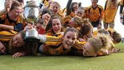 19 February 2012; Dublin City University captain Laura Twomey and her team-mates celebrate with the Purcell Cup. 2012 Purcell Cup Final, Dublin City University v Queen's University Belfast, Waterford IT, Waterford. Picture credit: Matt Browne / SPORTSFILE