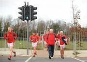 19 February 2012; Cork manager Eamon Ryan leads his players across the road from the training pitch to the match venue. Bord Gais Energy Ladies National Football League, Division 1, Round 3, Dublin v Cork, Ballyboden St. Enda's GAA Club, Ballyboden, Dublin. Picture credit: Pat Murphy / SPORTSFILE