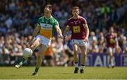 17 June 2017; Graham Gilfoyle of Offaly shoots as Ger Egan of Westmeath closes in during the Leinster GAA Football Senior Championship Quarter-Final Replay match between Westmeath and Offaly at TEG Cusack Park in Mullingar, Co Westmeath. Photo by Piaras Ó Mídheach/Sportsfile