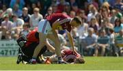 17 June 2017; Kevin Maguire of Westmeath checks on injured team-mate Paddy Holloway during the Leinster GAA Football Senior Championship Quarter-Final Replay match between Westmeath and Offaly at TEG Cusack Park in Mullingar, Co Westmeath. Photo by Piaras Ó Mídheach/Sportsfile