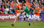 25 June 2017; Tomas Corrigan of Fermanagh has a shot at goal despite the attention of Rory Grugan, left, and Mark Shields of Armagh during the GAA Football All-Ireland Senior Championship Round 1B match between Armagh and  Fermanagh at the Athletic Grounds in Armagh. Photo by Oliver McVeigh/Sportsfile