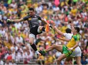 18 June 2017; Niall Morgan of Tyrone in action against Micheal Carroll of Donegal during the Ulster GAA Football Senior Championship Semi-Final match between Tyrone and Donegal at St Tiernach's Park in Clones, Co. Monaghan. Photo by Oliver McVeigh/Sportsfile