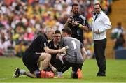 18 June 2017; Niall Morgan of Tyrone receives attention from Dr Damian O'Donnell, left, and Matthew Harte, team physiotherapist, centre, during the Ulster GAA Football Senior Championship Semi-Final match between Tyrone and Donegal at St Tiernach's Park in Clones, Co. Monaghan. Photo by Oliver McVeigh/Sportsfile