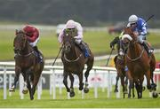 30 June 2017; Sea The Lion, right, with Ronan Whelan up, races Riven Light, with Pat Smullen up, who finished third, and Act of Valour, left, with Shane Kelly up, who finished second, on their way to winning the Irish Stallion Farms EBF 'Ragusa' Handicap during the Dubai Duty Free Irish Derby Festival 2017 on Friday at the Curragh in Kildare. Photo by Seb Daly/Sportsfile