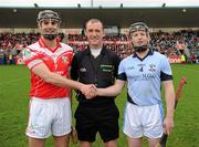 11 February 2012; Johnny Campbell, Loughgiel Shamrocks, shakes hands with Kieran Bermingham, Na Piarsaigh, right, in front of referee Anthony Stapleton before the game. AIB GAA Hurling All-Ireland Senior Club Championship Semi-Final, Loughgiel Shamrocks, Antrim v Na Piarsaigh, Limerick, Parnell Park, Dublin. Picture credit: Ray McManus / SPORTSFILE