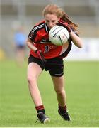 25 June 2017; Cara Thomson of Killygarry, Co. Cavan in action against Westport, Co. Mayo during the Girls Division 1 Shield Final at the John West Peile na nÓg national competition which took place this weekend across Cavan, Fermanagh and Monaghan. This is the second year that the Féile na nGael and Féile Peile na nÓg have been sponsored by John West, one of the world's leading suppliers of fish. The competition gives up-and-coming GAA superstars the chance to participate and play in their respective Féile tournament, at a level which suits their age, skills and strengths. Photo by Matt Browne/Sportsfile