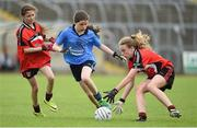 25 June 2017; Deirbhile Lynch of Killygarry, Co. Cavan in action against Westport, Co. Mayo during the Girls Division 1 Shield Final at the John West Peile na nÓg national competition which took place this weekend across Cavan, Fermanagh and Monaghan. This is the second year that the Féile na nGael and Féile Peile na nÓg have been sponsored by John West, one of the world's leading suppliers of fish. The competition gives up-and-coming GAA superstars the chance to participate and play in their respective Féile tournament, at a level which suits their age, skills and strengths. Photo by Matt Browne/Sportsfile