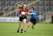 25 June 2017; Katie Lynch of Killygarry, Co. Cavan in action against Saoirse Kellt of Westport, Co. Mayo during the Girls Division 1 Shield Final at the John West Peile na nÓg national competition which took place this weekend across Cavan, Fermanagh and Monaghan. This is the second year that the Féile na nGael and Féile Peile na nÓg have been sponsored by John West, one of the world's leading suppliers of fish. The competition gives up-and-coming GAA superstars the chance to participate and play in their respective Féile tournament, at a level which suits their age, skills and strengths. Photo by Matt Browne/Sportsfile
