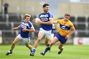 1 July 2017; Brendan Quigley of Laois in action against Sean Collins of Clare during the GAA Football All-Ireland Senior Championship Round 2A match between Laois and Clare at O'Moore Park in Portlaoise, Co Laois. Photo by Ramsey Cardy/Sportsfile