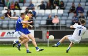 1 July 2017; Jamie Malone of Clare shoots to score his side's first goal of the game despite the efforts of Colm Begley, left, and Graham Brody of Laois during the GAA Football All-Ireland Senior Championship Round 2A match between Laois and Clare at O'Moore Park in Portlaoise, Co Laois. Photo by Ramsey Cardy/Sportsfile