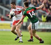 1 July 2017; Ciaran McFaul of Derry in action against Cillian O'Connor of Mayo during the GAA Football All-Ireland Senior Championship Round 2A match between Mayo and Derry at Elverys MacHale Park, in Castlebar, Co Mayo. Photo by David Maher/Sportsfile