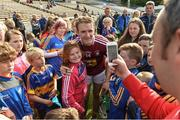 1 July 2017; Amy Lillis, aged 10, from The Ragg, Co. Tipperary gets her photograph taken with Noel McGrath of Tipperary after the GAA Hurling All-Ireland Senior Championship Round 1 match between Tipperary and Westmeath at Semple Stadium in Thurles, Co Tipperary. Photo by Diarmuid Greene/Sportsfile
