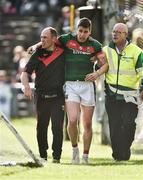 1 July 2017; Lee Keegan of Mayo is helped off the pitch by medical staff during the GAA Football All-Ireland Senior Championship Round 2A match between Mayo and Derry at Elverys MacHale Park, in Castlebar, Co Mayo. Photo by David Maher/Sportsfile