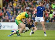 1 July 2017; Liam Connerton of Longford in action against Neil McGee of Donegal during the GAA Football All-Ireland Senior Championship Round 2A match between Donegal and Longford at MacCumhaill Park in Ballybofey, Co Donegal. Photo by Oliver McVeigh/Sportsfile