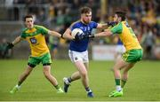 1 July 2017; Conor Berry of Longford   in action against Eoin McHugh and Ryan McHugh of Donegal during the GAA Football All-Ireland Senior Championship Round 2A match between Donegal and Longford at MacCumhaill Park in Ballybofey, Co Donegal. Photo by Oliver McVeigh/Sportsfile