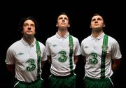 27 February 2012; Three, proud sponsors of the Republic of Ireland football team, today launches the new Umbro Republic of Ireland away jersey. Pictured wearing the new kit are Republic of Ireland players, from left, Stephen Hunt, Kevin Foley, and Shane Long. The Three sponsored jersey is available now and will be worn for the first time on the pitch for the Republic of Ireland's Euro 2012 warm up friendly match against the Czech Republic on Wednesday 29th February. To celebrate the launch, Three is giving away 8 pairs of tickets to the match, just go to www.facebook.com/3Football for more details, terms and conditions and apply. Gannon Park, Malahide, Co. Dublin. Picture credit: David Maher / SPORTSFILE
